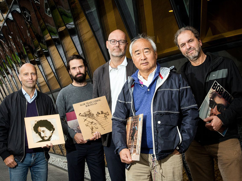 A supplied image obtained Tuesday, Dec. 15, 2015 of scientists and Bob Dylan fans at the Karolinska Institute. A group of scientists at the Karolinska Institute in Sweden had been sneaking the lyrics of Bob Dylan into their papers as part of a long running bet. (AAP Image/The BMJ) NO ARCHIVING, EDITORIAL USE ONLY